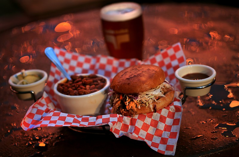 The pulled pork sandwich with beans as a side with a glass of HopMonk Tavern Ale, Thursday Dec. 8, 2016 at the Twin Oaks Road House in Penngrove. (Kent Porter)