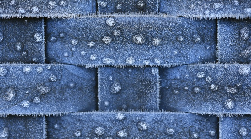 Frozen dew drops and needle ice on patio furniture Monday morning Dec. 19, 2016 in Windsor. (Kent Porter