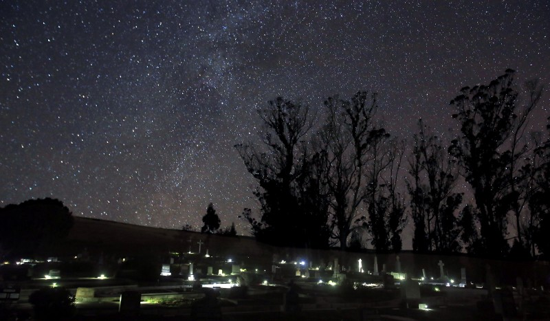 The Bodega Cemetery is lit with solar lights under a starry sky, Tuesday Dec. 20, 2016. (Kent Porter /