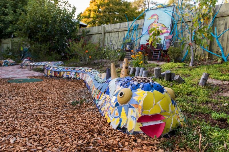 Carole Watanabe built a slithering dragon o random ceramics that weaves its way through the garden.