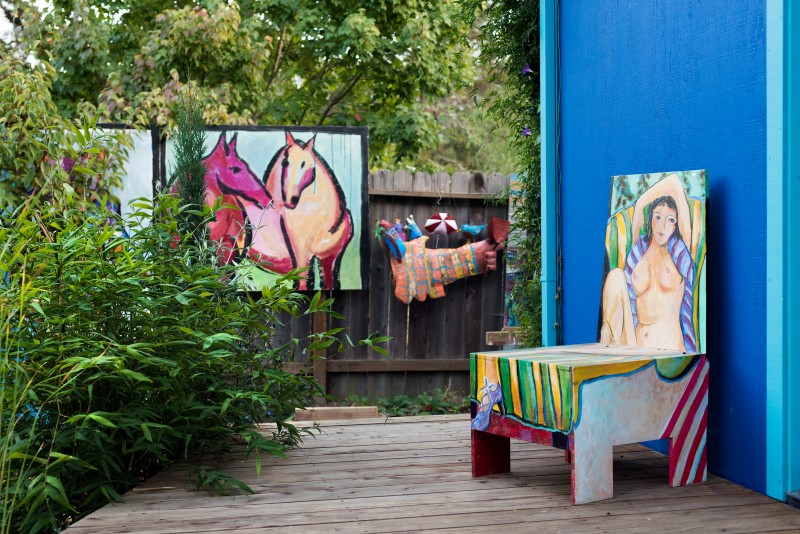 One of Watanabe's chair paintings sits on the back porch.