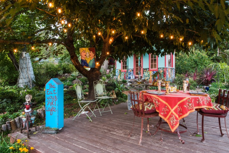 "The backyard deck, dubbed ""The Eat Your Art Cafe,"" is a favorite spot for relaxation and teatime."