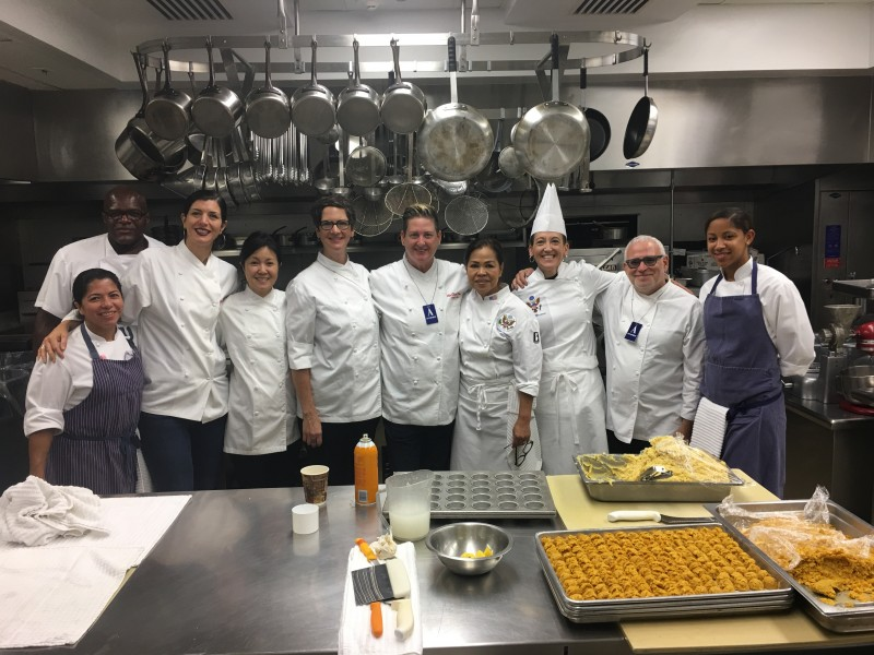Jennifer Johnson poses with White House Executive Chef Cristeta Comerford, fourth from right, and the kitchen crew.