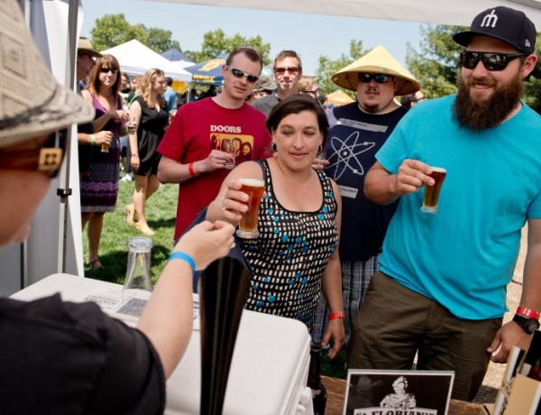 Amy Levin pours St. Florian beer at  Beerfest.