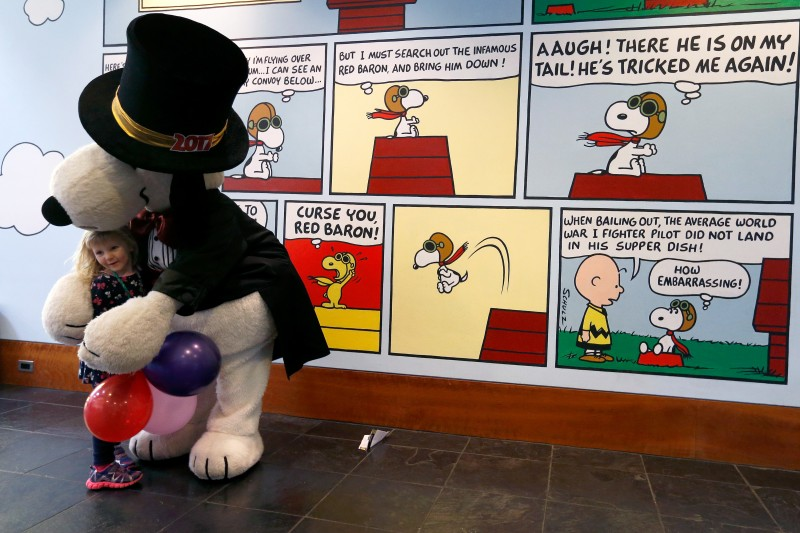 Quinn Davis, 3, gets a big hug from Snoopy during the kids New Year's Eve celebration at the Charles M. Schulz Museum in Santa Rosa, California on Saturday, December 31, 2016. (Alvin Jornada / The Press Democrat)
