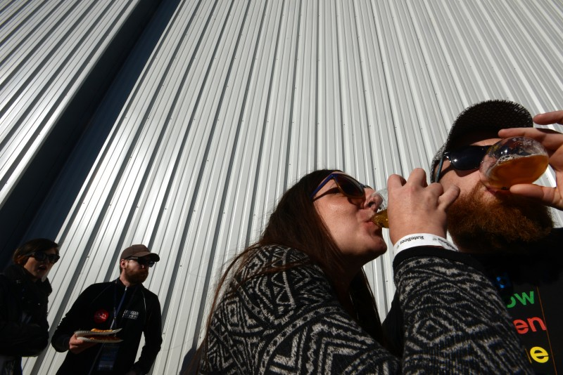 Heather Wacker, left and Daniel Baggett both from Santa Rosa, California during RateBeer Best International Beer Festival held at Kaiser Air Inc. private hangar Sunday in Santa Rosa, California. January 31, 2016. (Photo: Erik Castro/for The Press Democrat)
