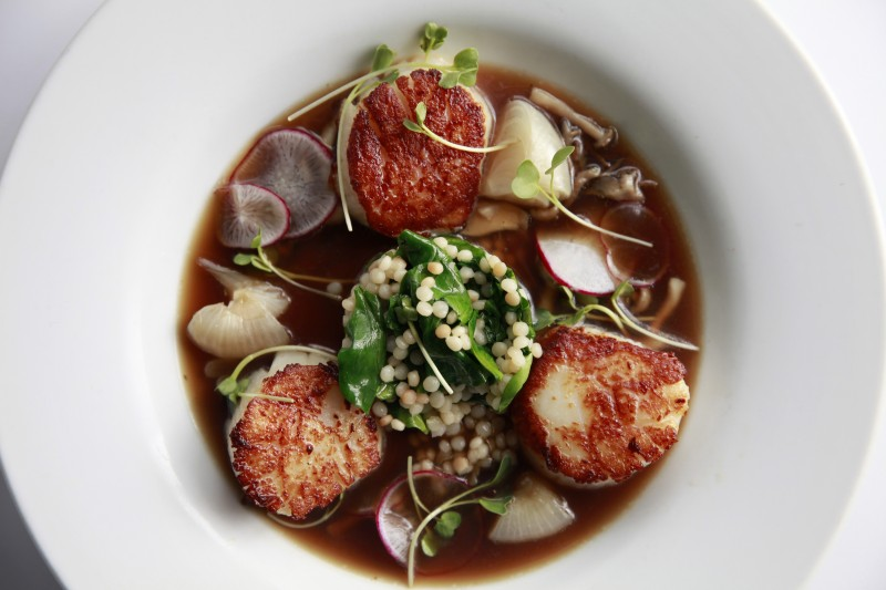 Dayboat scallops in a jasmine-dashi broth and pearl pasta with spinach at Cafe La Haye on Thursday, March 27, 2014 in Sonoma, California. (BETH SCHLANKER/ The Press Democrat)