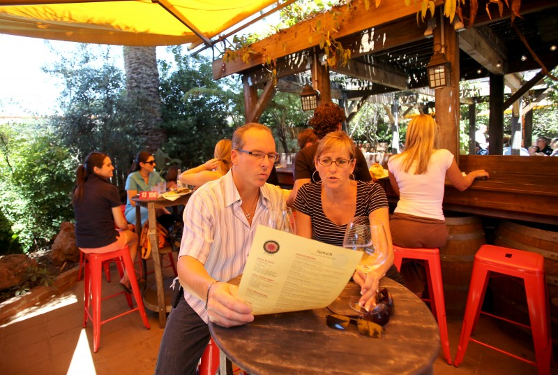 Archie Raines, left, and Celeste Raines, both of Nashville, check out the menu at Sunflower Caffe in Sonoma, July 21, 2012. The two had eaten at the restaurant three times in two days. Crista Jeremiason