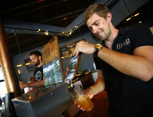 Fraser Ross pours a beer for the Friday crowd at Fogbelt Brewing Company in Santa Rosa, June 27, 2014. (Conner Ja