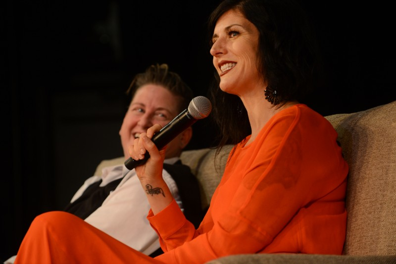 Jennifer Johnson laughs at a comment her wife and business partner, Serafina Palandech, makes to the audience during their appearance at the Sonoma County Women in Conversation series. (Erik Castro)