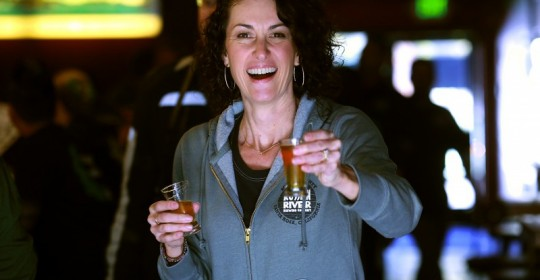 Russian River Brewing Company owner Natalie Cilurzo offers a test of Pliny the Younger to the photographer before the release in Santa Rosa on Friday. (JOHN BURGESS