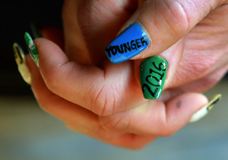 Waitress Alison Bellman painted her nails for the release of Pliny the Younger at Russian River Brewing Company in Santa Rosa on Friday. (JOHN BURGESS / The Press Democrat) pliny John Burgess