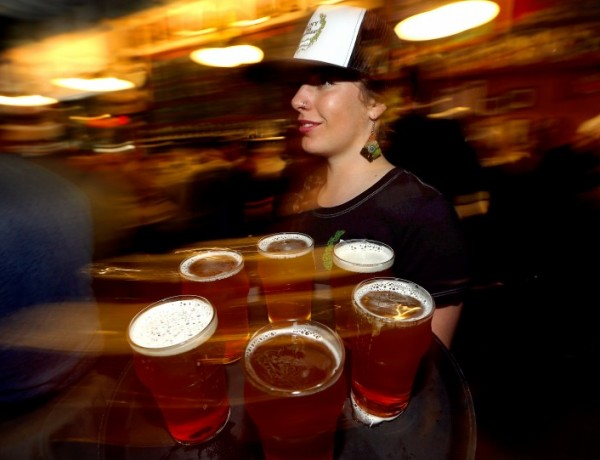 Chloe Smith delivers another round of Pliny the Younger at Russian River Brewing Company in Santa Rosa on Friday. (JOHN BURGESS