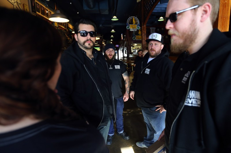 The security team at Russian River Brewing Company talk about how to handle the lines and the door for the opening day of Pliny the Younger in Santa Rosa on Friday. (JOHN BURGESS / The Press Democrat)