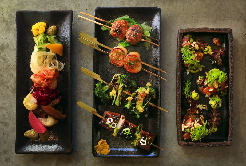 l to r) The Pickle Plate, Yakitori (from top; Chicken Tsukune, Hokkaido Scallop, Broccoli, and Wagyu Short Rib) and Maguro Poke from Ramen Gaijin in Sebastopol. (John Burgess/The Press Democrat)