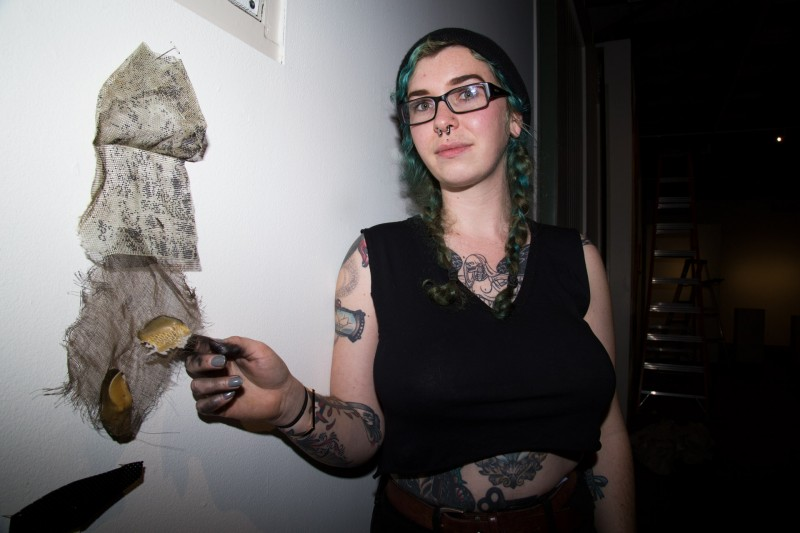 Artist Jaynee Watson next to one of her installations at the