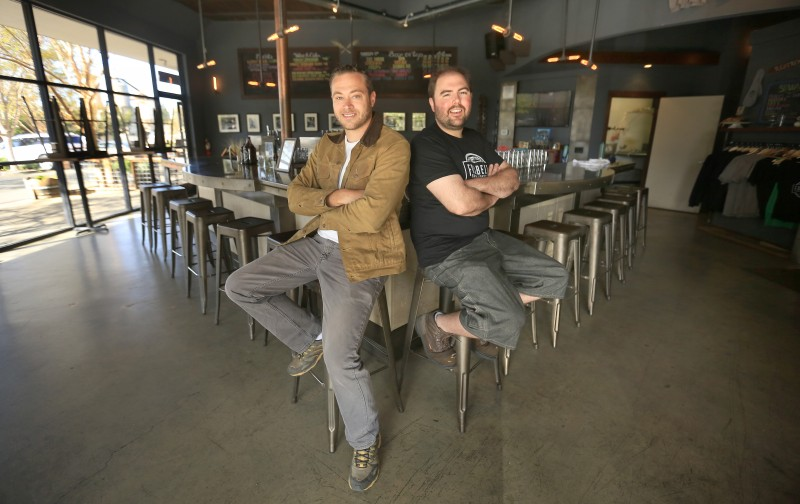 Paul Hawley, left and Remy Martin of Fogbelt Brewing in Santa Rosa, Monday March 30, 2015. (Kent Porter / Press Democrat)