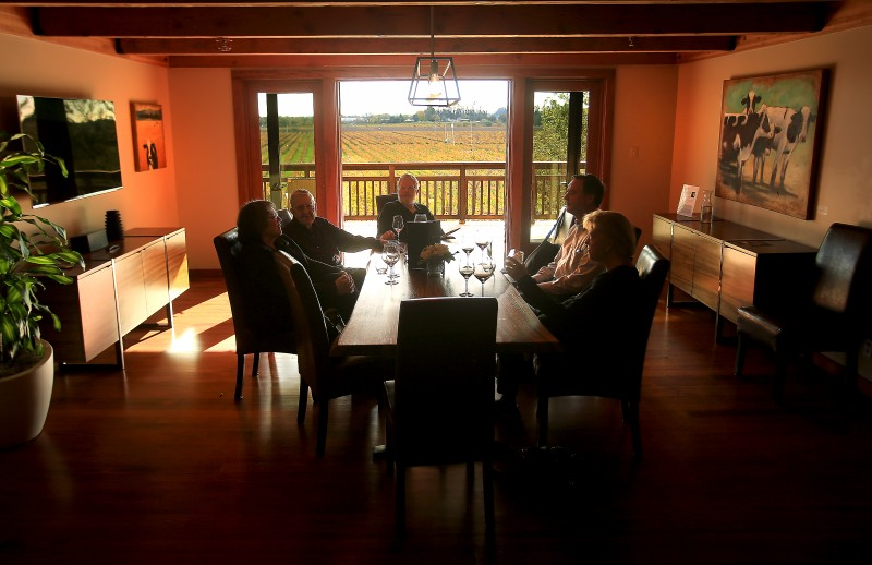 Visitors sample La Crema wines in Saralee's Salon, where the fourth-floor setting offers sweeping vineyard views. (Kent Porter)