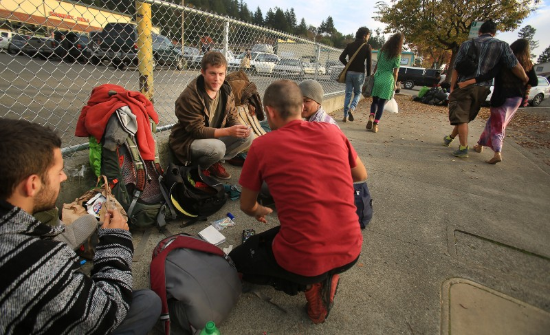 On the streets of Garberville in Humboldt County, young men from Spain, Argentina and Honduras pass the time as they look for work harvesting marijuana. (Kent Porter)