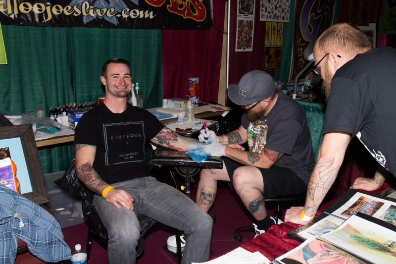 Jake St. George gets a tattoo at the Tattoo & Blues Festival at the Flamingo Hotel in Santa Rosa.