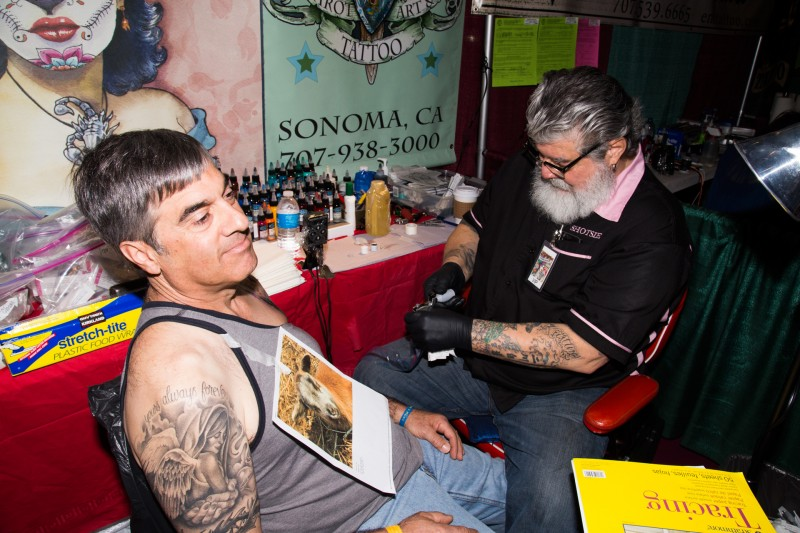 John Balisteri gets lamb taottoo at Tattoo & Blues Festival at the Flamingo Hotel in Santa Rosa.