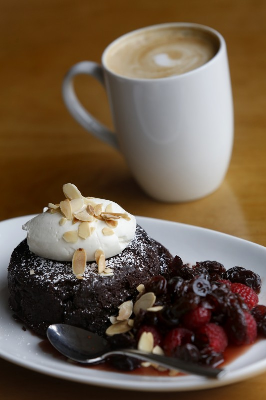 Flourless chocolate cake with dried cherry compote, fresh raspberries, whipped creme fraiche sprinkled with sliced almonds at The Spinster Sisters in Santa Rosa, on Thursday, December 8, 2016. (BETH SCHLANKER/