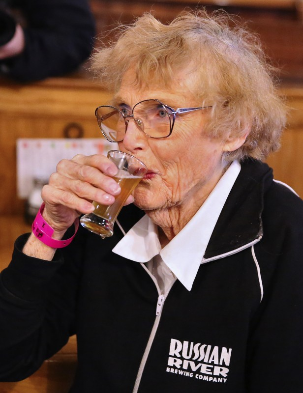 Audrey Cilurzo, mother of Russian River Brewing Company owner Vinnie Cilurzo, samples a glass of Pliny the Younger in Santa Rosa, on Friday, February 3, 2017. (Christopher Chung/ The Press Democrat) Pliny the Younger