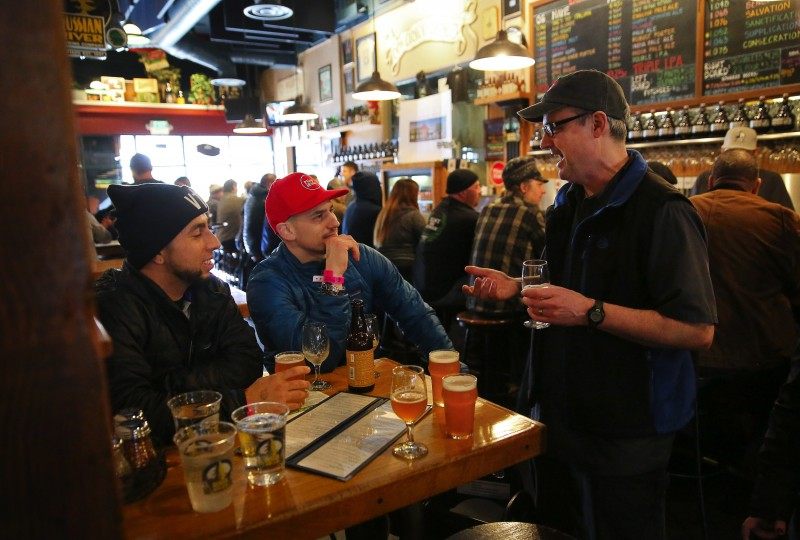 Russian River Brewing Company owners Natalie, left, and Vinnie Cilurzo raise glasses of Pliny the Younger with their staff before opening their doors to customers in Santa Rosa, on Friday, February 3, 2017. (Christopher Chung