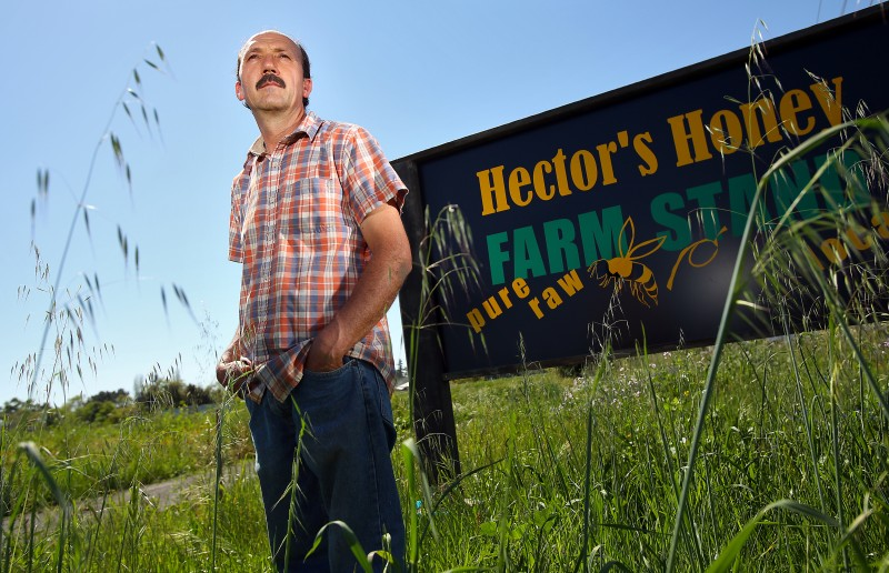 Beekeeper Hector Alvarez sells his Hector's Honey at his River Road farm stand. (Christopher Chung
