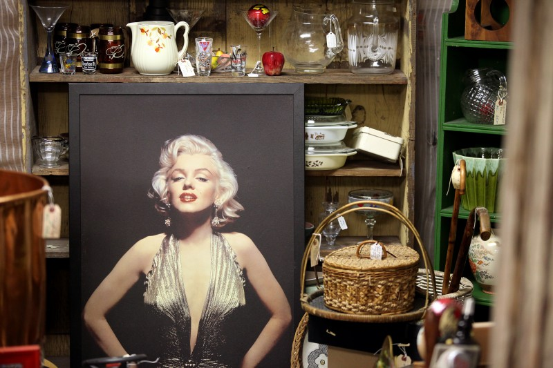A large framed poster of Marilyn Monroe sits among a medley of items for sale at Whistlestop Antiques in Santa Rosa's Railroad Square. Christopher Chung
