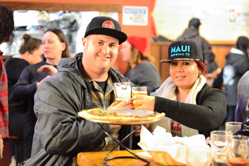 Visitors enjoying their brews with beer bites and pizza at Russian River Brewing Company. Three hours may seem like a long time, but it's not when the beer and bites are so delicious! Order right away so you have more time to enjoy! (Photo by Tim Vallery)