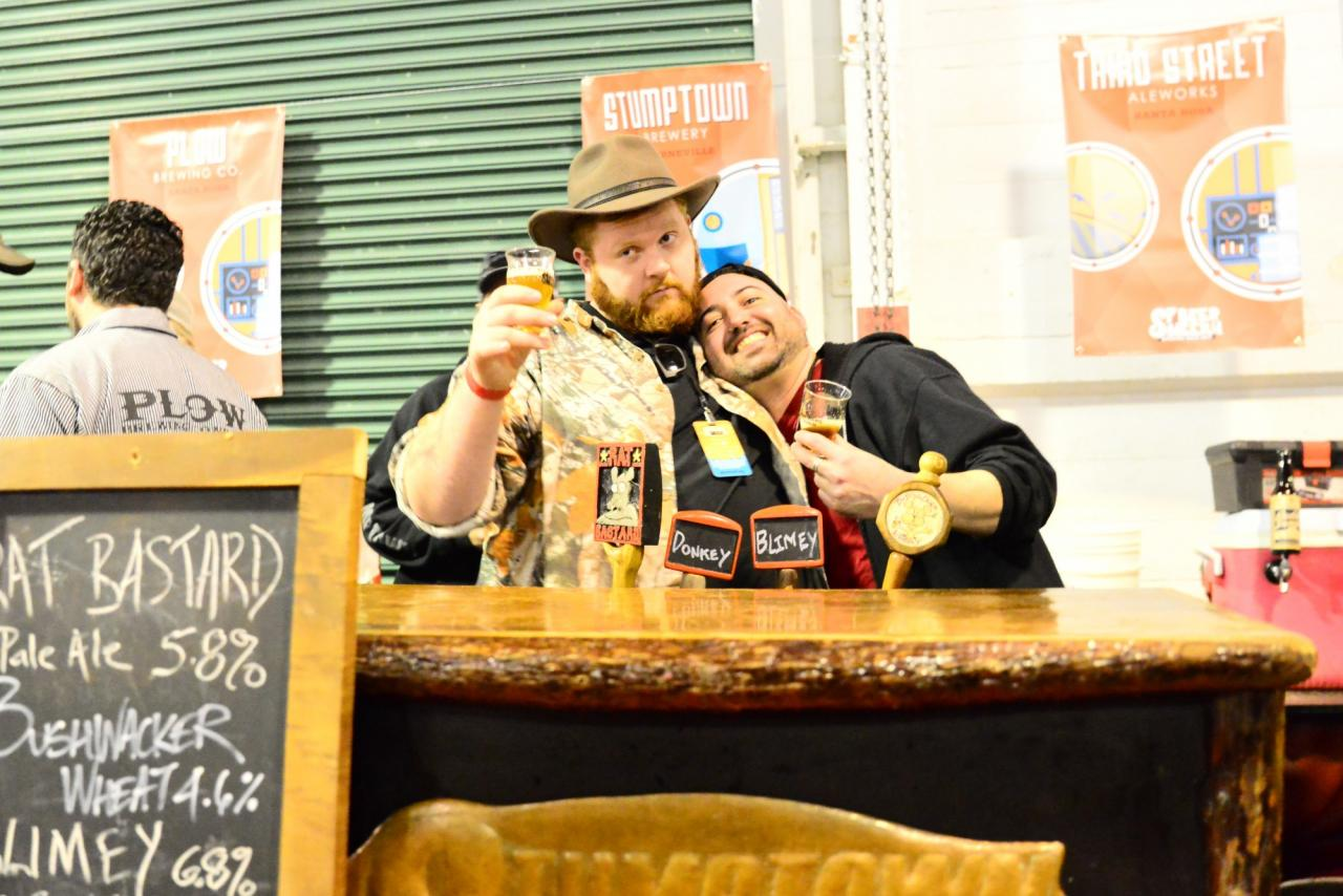 "Nick Garson aka ""Fridge"" a local beer celebrity, hugs up on the Stumptown team as he assists them in pouring the brews at the Sf beer week opening gala. (Photo by Tim Vallery)"