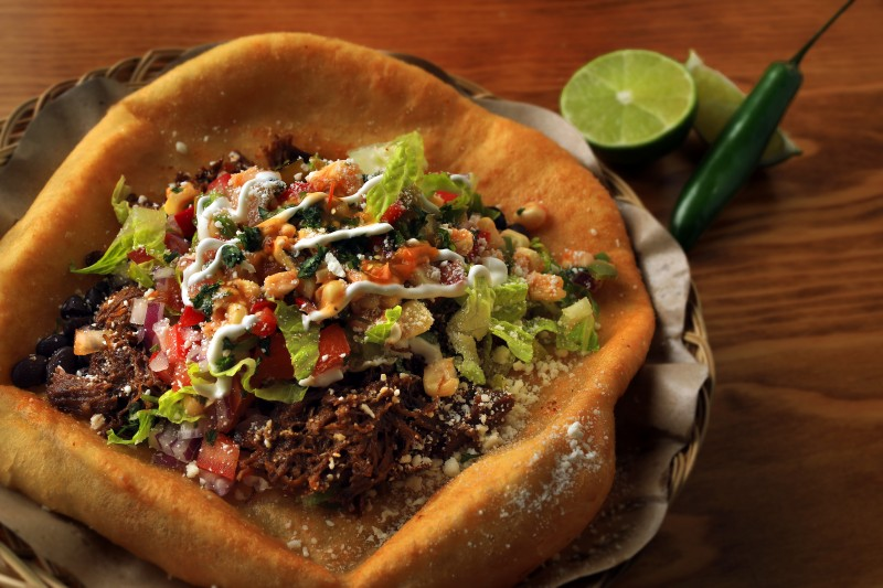Shredded Chocolate-Coffee Braised Bison Open Face Fry Bread Taco with Calypso Beans, Cotija cheese, Sour Cream, and BBQ Corn-Cranberry-Anaheim-Serrano Salsa at the Werowocomoco restaurant at the Virginia Dare Winery in Geyserville. (John Burgess/The Press Democrat) John Burgess