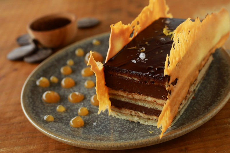 Opera Cake features layers of almond sponge cake, chocolate ganache and Plank coffee buttercream with ginger sauce from the Trading Post Market & Bakery in Cloverdale. (John Burgess/The Press Democrat)