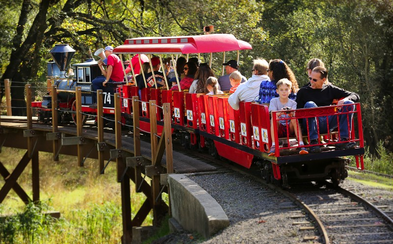 Passengers ride on a simulated 1863 C.P. Huntington steam train at Howarth Park in Santa Rosa, California on Sunday, September 29, 2013. (BETH SCHLANKER/