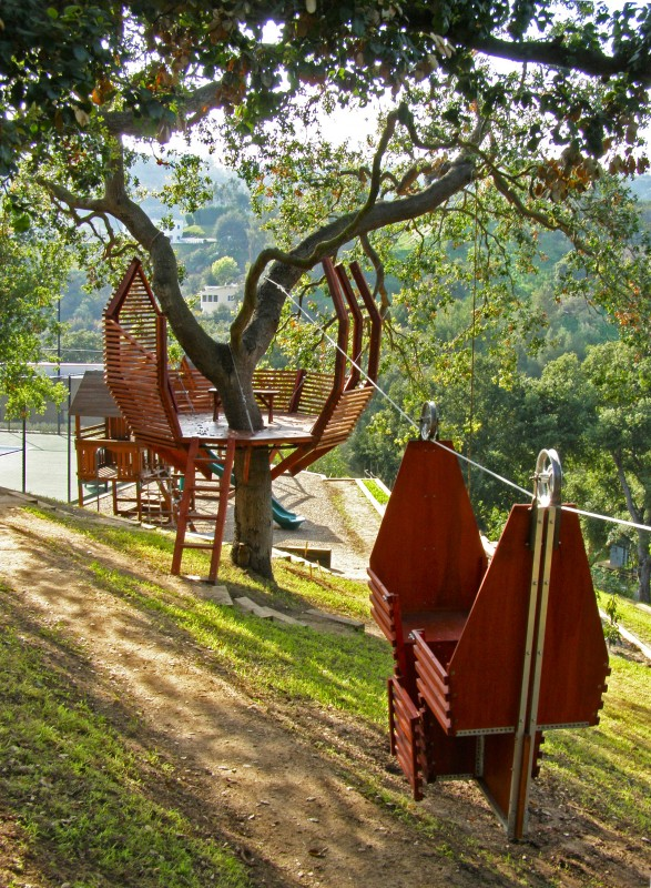 "The ""Lotus"" treehouse A ship-like two seat wooden cable car creates quick transportation between the two hillside structures, which can also be entered by wooden steps. Materials: Doug Fir, Steel Central Hubs & Ring, Marine Plywood"