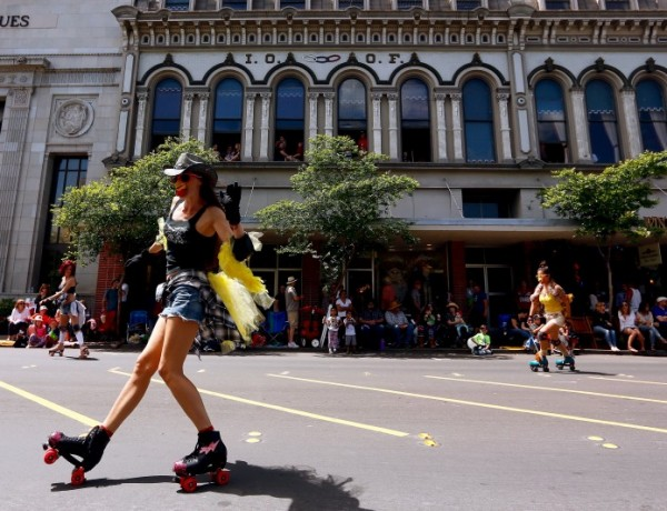 Rollerskaters zip by during the Butter and Egg Days Parade in Petaluma, California, on Saturday, April 23, 2016. (Alvin Jornada / The Press Democrat)  Butter and Egg Days Parade