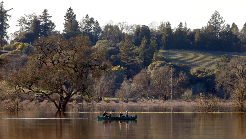 The Niklasson family, from left, Johan, Tindra, 11, Freja, 13, and Courtney paddle their canoe on the Laguna de Santa Rosa, north of Occidental Road, which has swollen from recent rainfall, in Santa Rosa, California on Saturday, February 11, 2017. (Alvin Jornada