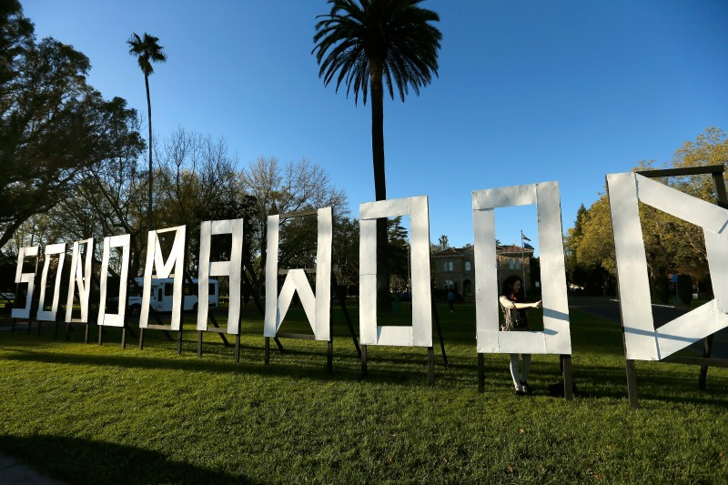 Film festival staffer Alejandra Hernandez of San Francisco gives a thumbs up after a friend snapped her photo standing in the Sonomawood sign at the Sonoma International Film Festival in Sonoma, California on Thursday, March 31, 2016. (Alvin Jornada