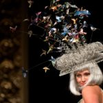 Lauren Benward-Krause models a hat made from a rotating fan, recycled wire and origami birds from old magazine pages, designed by Joni Derickson and Alexa Wood, during the Trashion Fashion Show, where designers create outfits out of recycled materials, at the Sonoma Community Center in Sonoma, Calif., on April 26, 2013. (Alvin Jornada