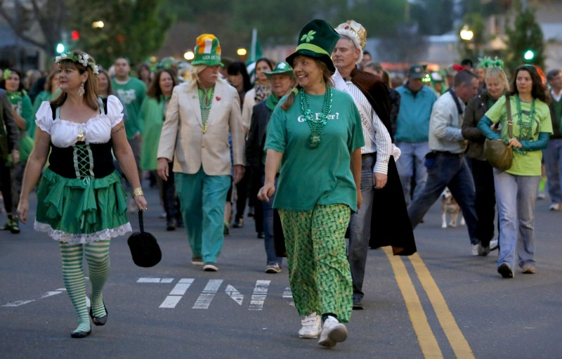Participants in the St. Patrick's Day parade walk down Healdsburg Ave. in Healdsburg, on Tuesday, March 17, 2015. (BETH SCHLANKER