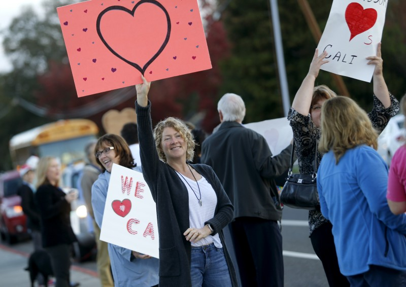 In response to recent vandalism, community members including Susan Nelson show their support for Cali Calmecac Language Academy before the start of class in Windsor, on Wednesday, October 26, 2016. (BETH SCHLANKER