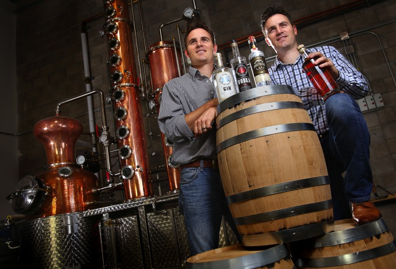 Twin brothers Chris, left, and Brandon Matthies own and operate Sonoma Brothers Distilling, in Windsor. The brothers produce their own line of gin, vodka and whiskey in their handmade Arnold Holstein copper pot still. (Christopher Chung)
