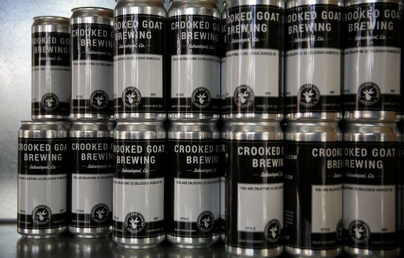 Crowlers behind the bar at Crooked Goat Brewing, in Sebastopol. (Christopher Chung)