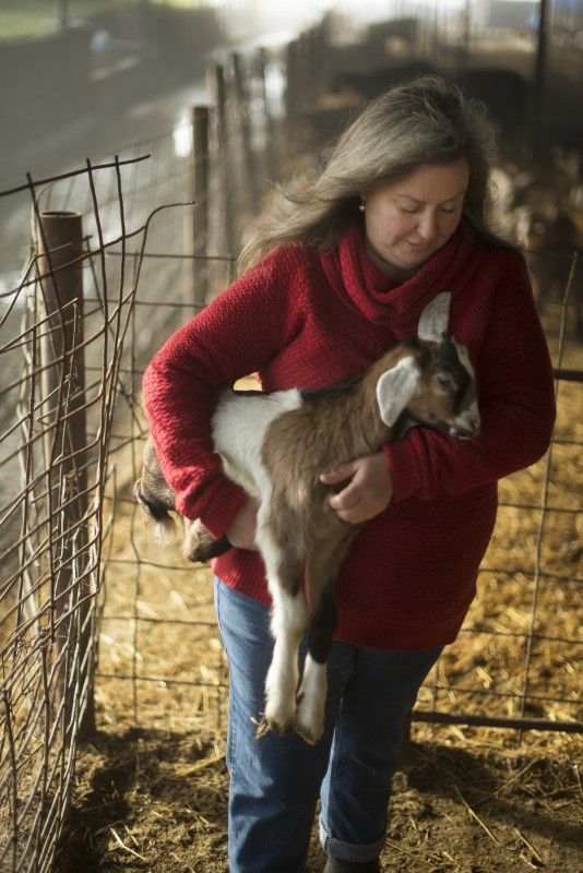Donna Pacheco with one of her newborn Nubian goats at Achadinha Cheese Company in Petaluma. (Erik Castro)