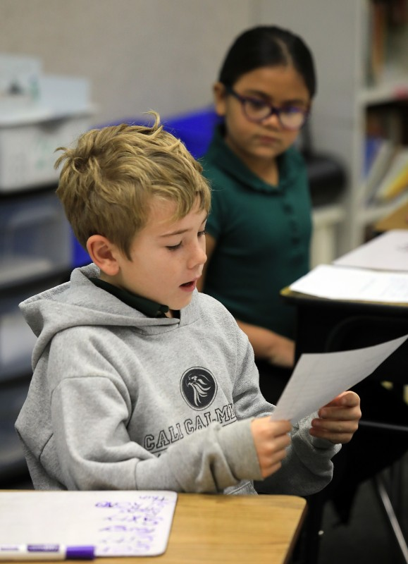 Cali Calmecac Language Academy third grader's in Rosa Villalpondo class wrote formal letters to President Donald Trump or outgoing President Barak Obama on inauguration day. Liam Wallace, 8, reads his letter to the class. (John Burgess