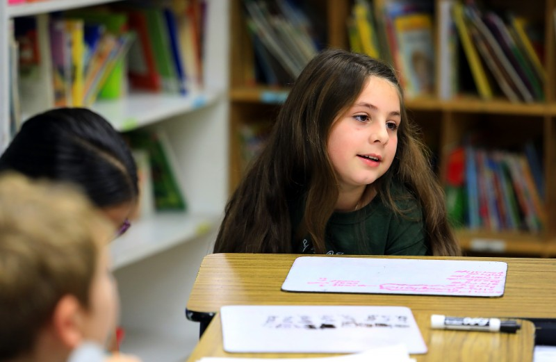 Cali Calmecac Language Academy third grader's in Rosa Villalpando class wrote formal letters to President Donald Trump or outgoing President Barak Obama on inauguration day. Aleena Galvani, 9, said she hopes President Trump will be a good President. (John Burgess)