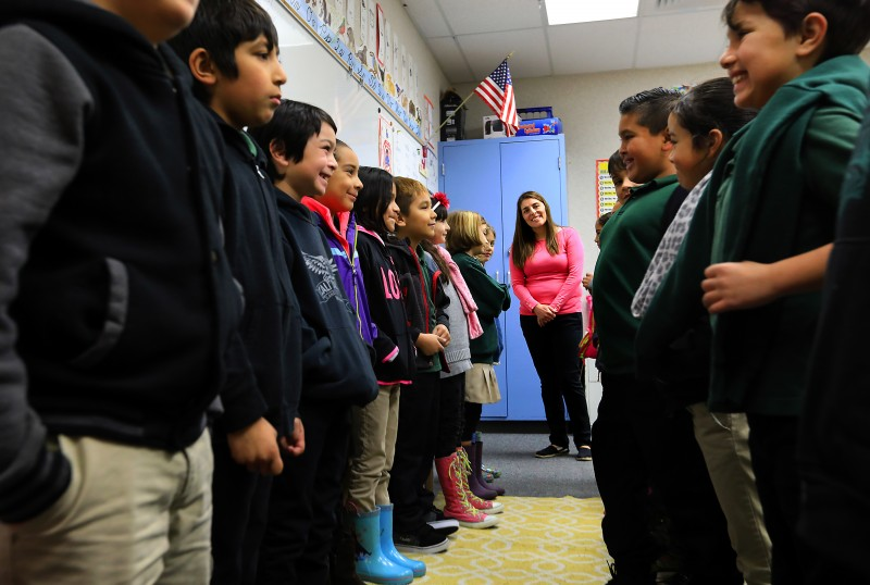 Cali Calmecac Language Academy teacher Rosa Villalpando directs her third grade class in an exercise where you greet the student across from you and ask them questions about their thoughts and goals. (John Burgess