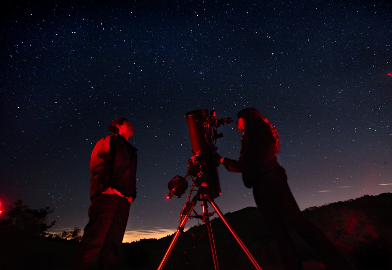 SRJC astronomy students Marcos Indalecio, left, and Melanie Queiroz view the stars through a telescope belonging to amateur astronomer Dickson Yeager during the monthly public viewing night at the Ferguson Observatory in Sugarloaf Park. In addition to three permanent large telescopes, members of the observatory often bring their personal scopes for the public to enjoy. John Burgess