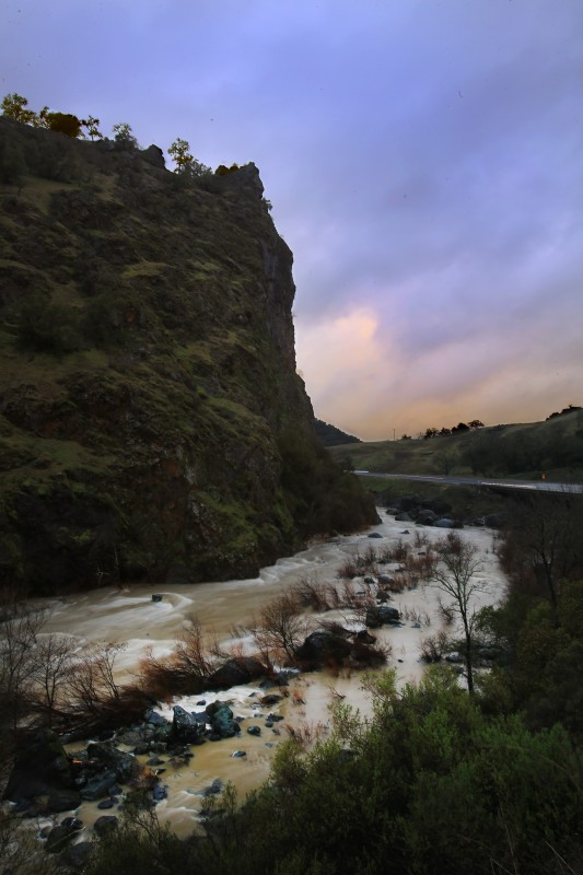 A swollen Russian River flows past Frog Woman Rock along Highway 101 north of Cloverdale, Friday Feb. 3, 2017. (Kent Porter